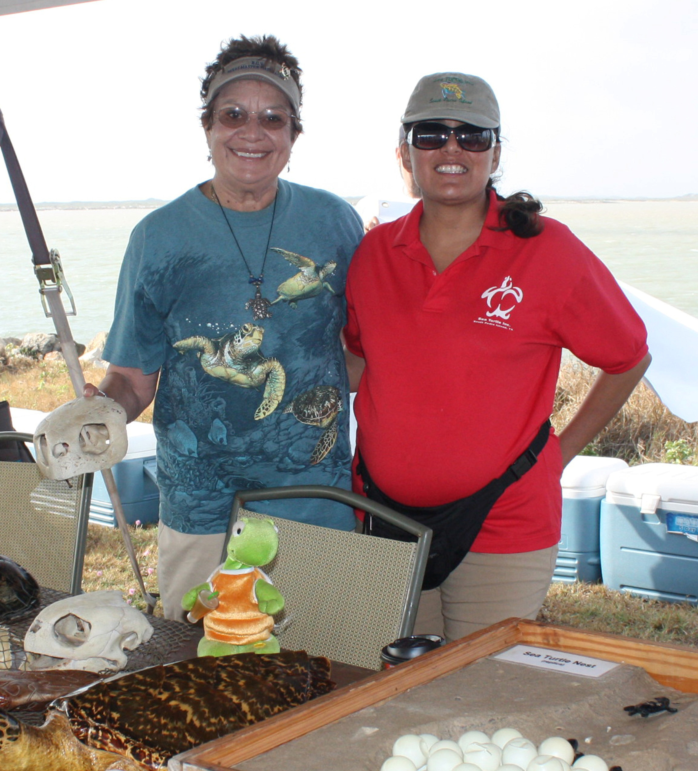Lucy with Mary Ann Tous at the South Padre Island Beach Jetties Cleanup